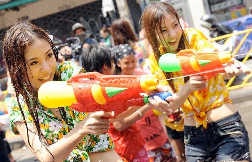 Two girls enjoying Songkran in Khao Lak
