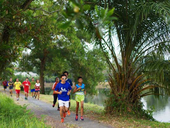 Runners at the lake in Khao Lak