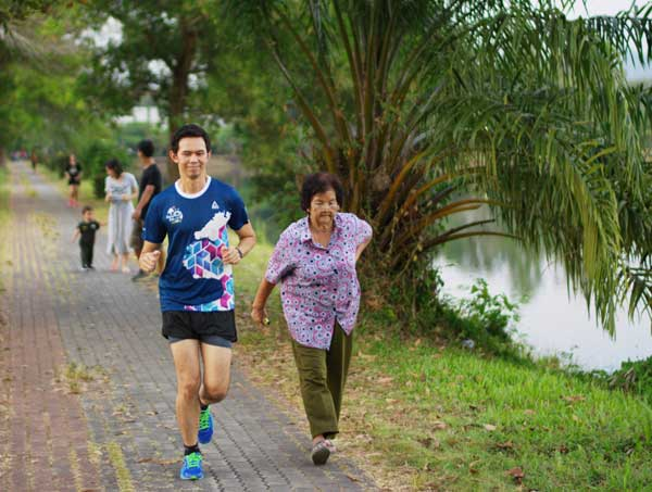Young and old running in Khao Lak